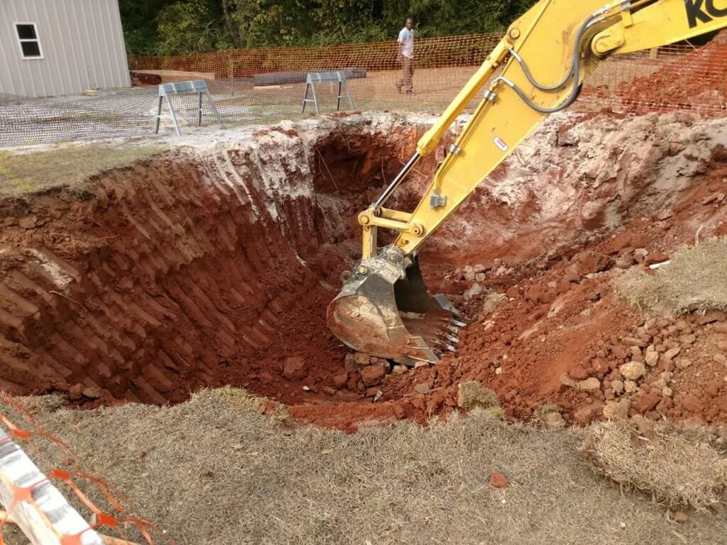 Working on a large sinkhole in Alabama.