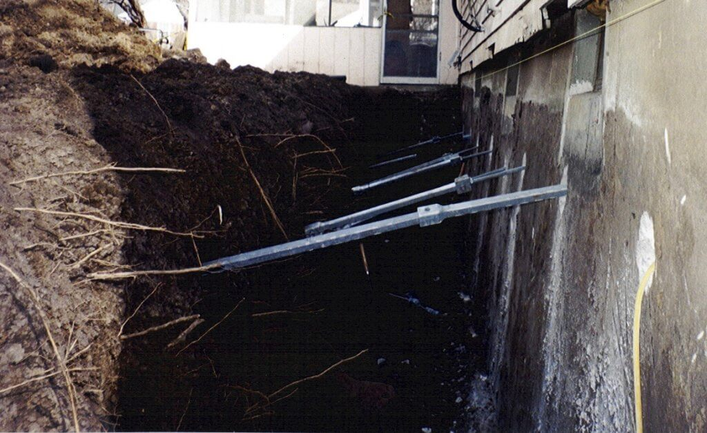 helical tiebacks for wall support as a foundation repair solution